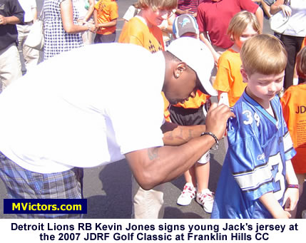 Lions RB Kevin Jones signs a jersey at JDRF Golf Outing 2007