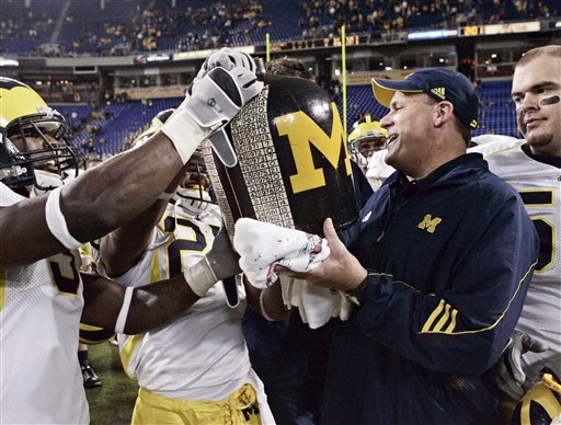 Rich Rodriguez get the Little Brown Jug (AP Photo)