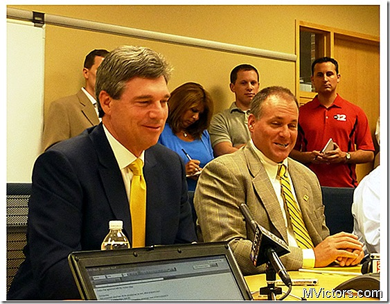 Dave Brandon and Rich Rodriguez at NCAA response teleconference