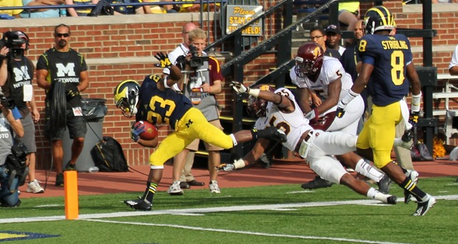 Dennis Norfleet heads out of bounds