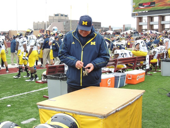 Jon Falk opens the case holding The Little Brown Jug - 2012