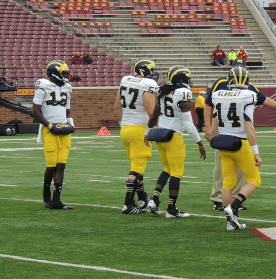 Michigan quarterbacks warm-up - Minnesota