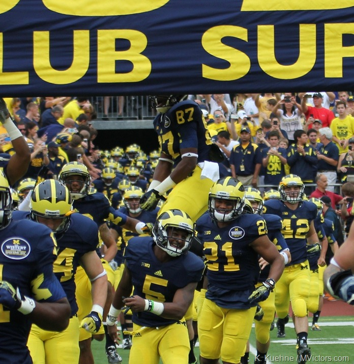 Funchess Leaps over Michigan banner
