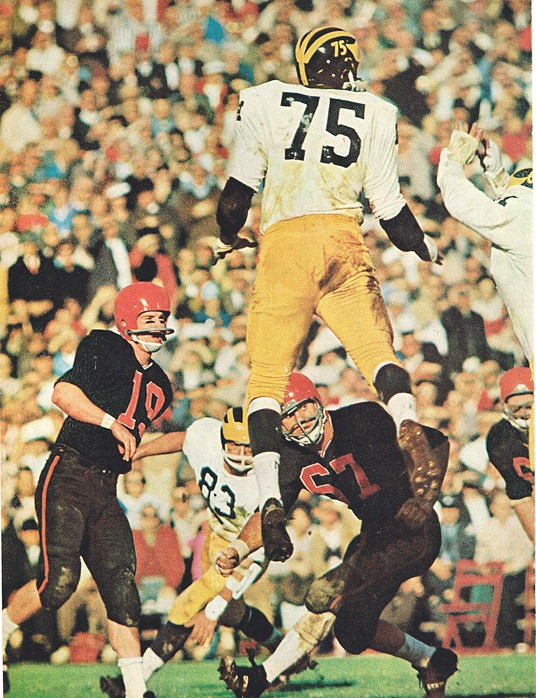 Bill Yearby of Michigan leaps during 1965 Rose Bowl (vs. Oregon State)